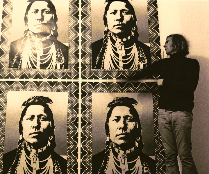 John Van Hamersveld with theIndianposter, 1968. Photograph by Ron Cooper. Image courtesy John Van Hamersveld.