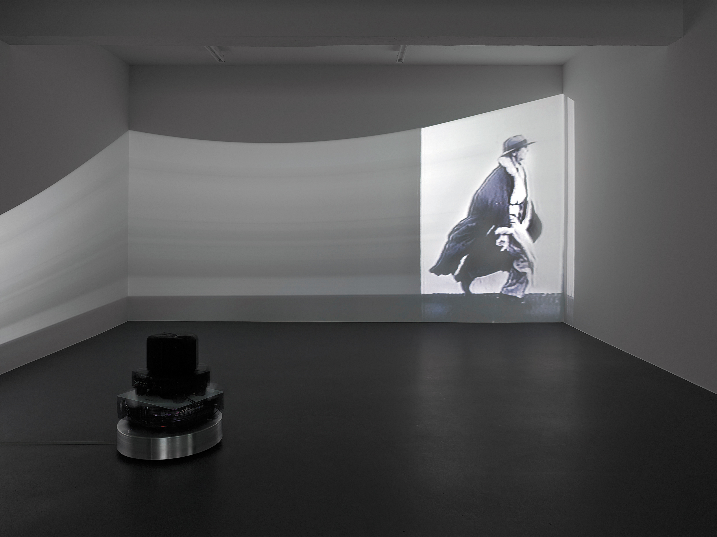 Sturtevant. Dillinger Running Series. 2000. Single channel video installation on rotating platform; video: black and white, sound. Dimensions variable; video: 26 min., 55 sec. Julia Stoschek Foundation e.V., Düsseldorf. Photo: Simon Vogel. © Estate Sturtevant, Paris.