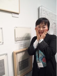 Asako Setoh posing next to her works, photo by author.